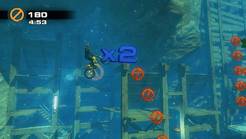There are five Challenges to go along with the main game.  These are weird activities like getting as far as you can with a finite amount of gas or, as pictured above, a sort of platformer/stunt bike crossover.